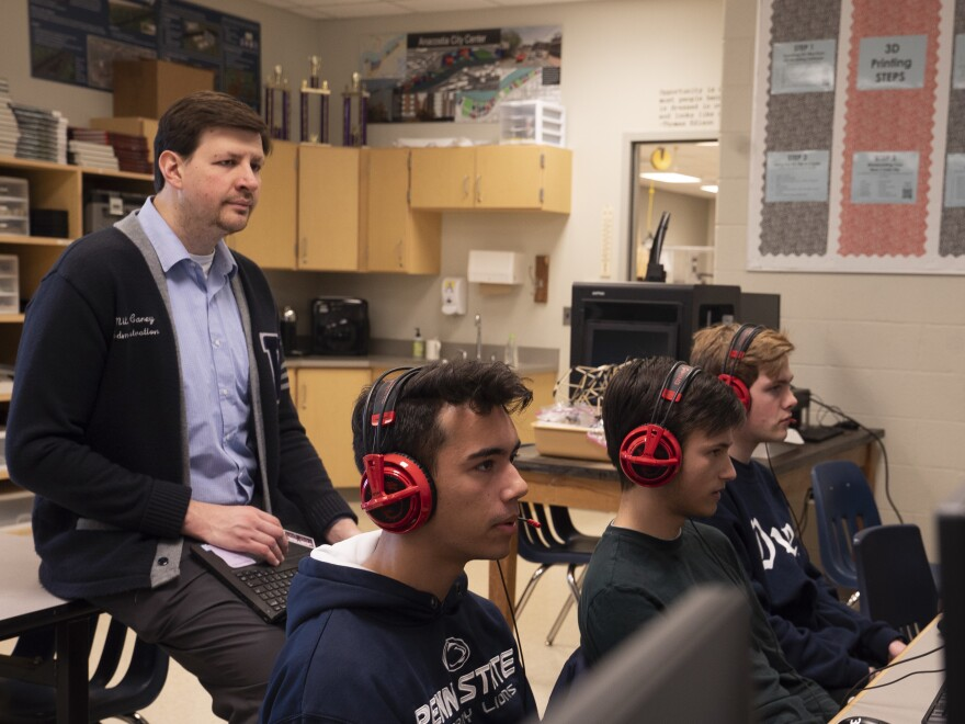 Assistant Principal Miles Carey oversees a Rocket League practice at Washington-Liberty High School in Arlington, Va.