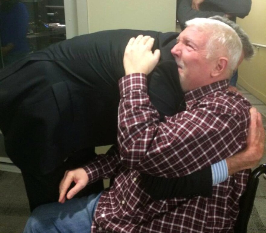 Steve Julian of KPCC in Los Angeles gets a studio named after him, and a great big hug from President and CEO Bill Davis.