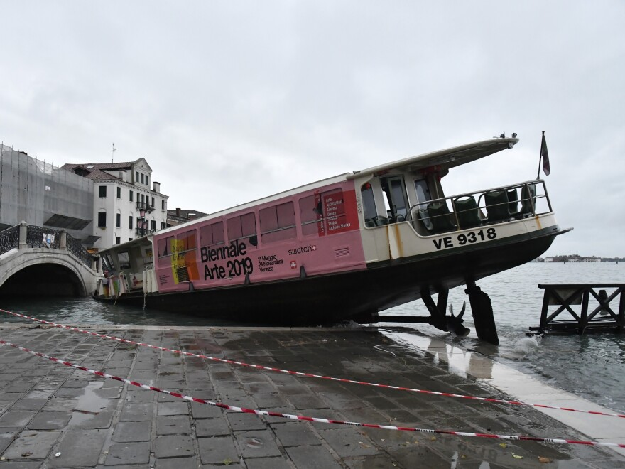 A ferry boat lies stranded in Venice on Wednesday, the victim of extremely high tides. Venice's mayor blames climate change for flooding in the historic canal city.