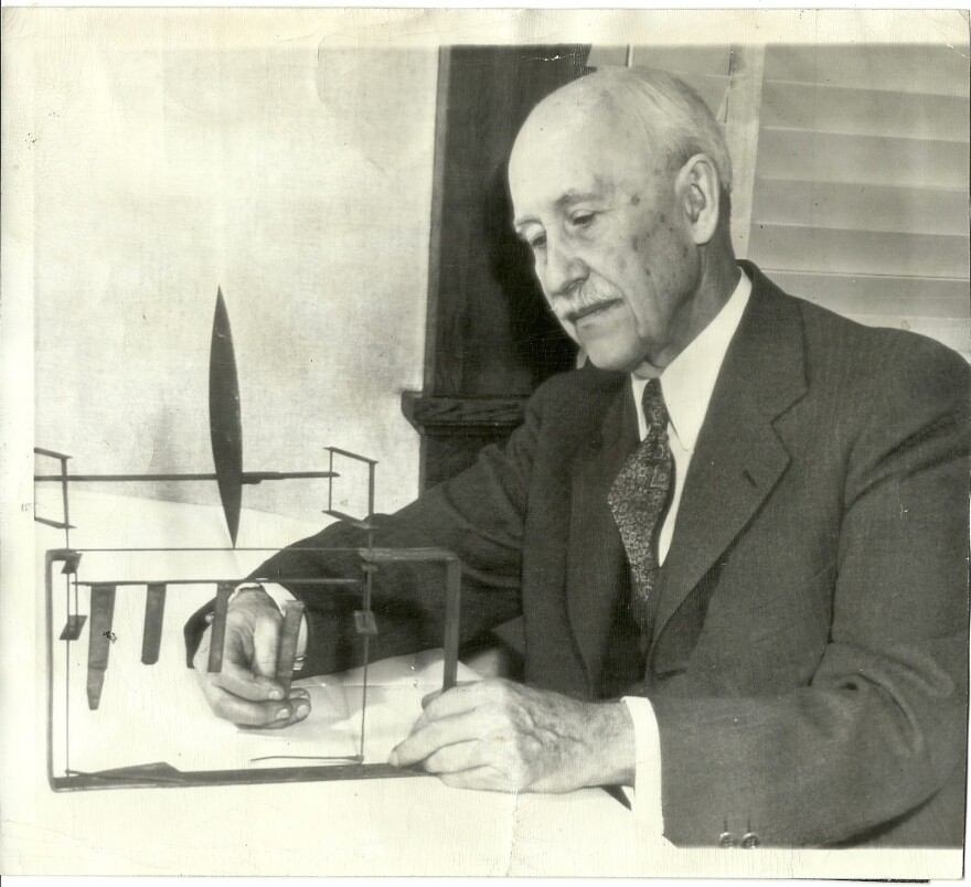 Orville Wright with wind tunnel components