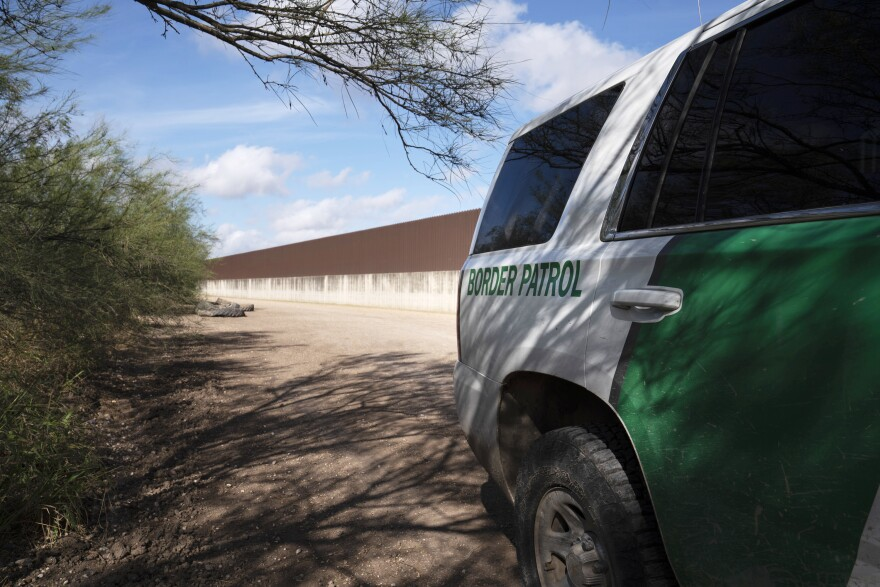 A Border Patrol vehicle is parked near the existing border wall south of Donna, Texas.