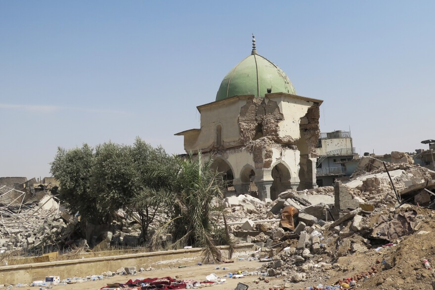 Ruins are all that remain of the 12th century Great Mosque of al-Nuri, where ISIS leader Abu Bakr al-Baghdadi declared three years ago that an Islamic state was rising again. ISIS blew the mosque up as Iraqi forces advanced.