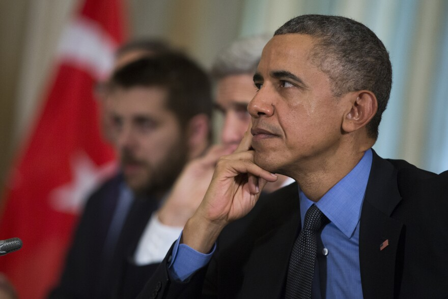 President Obama listens to Turkish President Recep Tayyip Erdogan during a bilateral meeting in Tuesday in Paris.