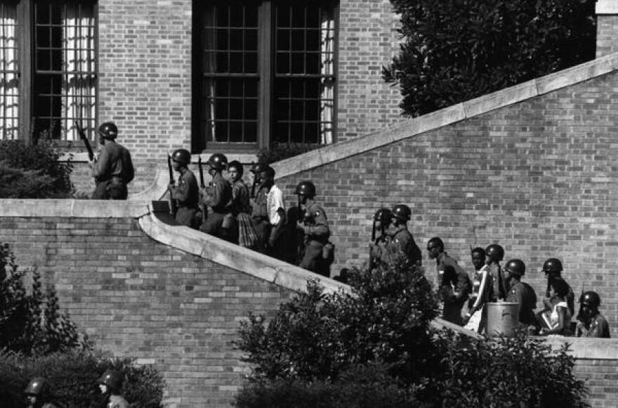 Members of the 101st Airborne Division of the U.S. Army escort the Little Rock Nine up the steps and into Central High School on Sept. 25, 1957.