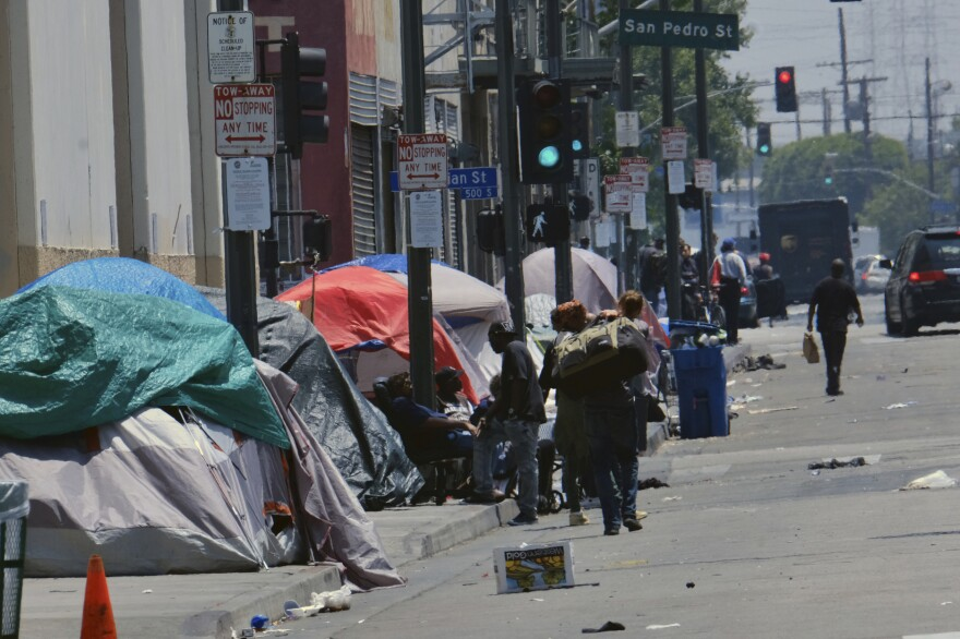 Tents housing homeless line a street near the LAPD Central Community Police Station in downtown Los Angeles.