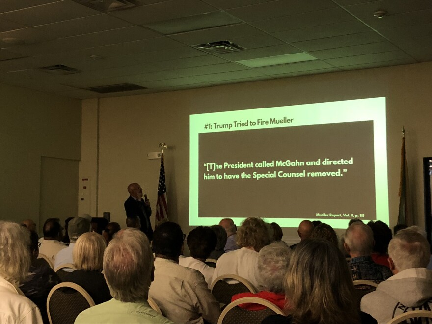 Congressman Ted Deutch shows excerpts of the Special Counsel's report at a town hall meeting Thursday.
