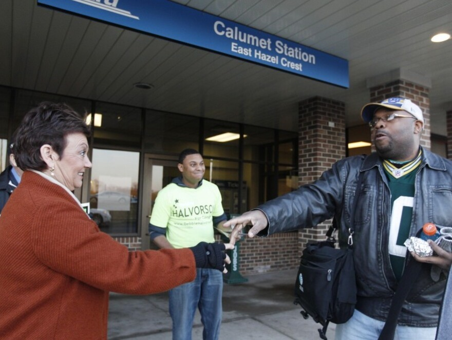 Democratic congressional candidate Debbie Halvorson greets commuters in East Hazel Crest, Ill., on Jan. 31.