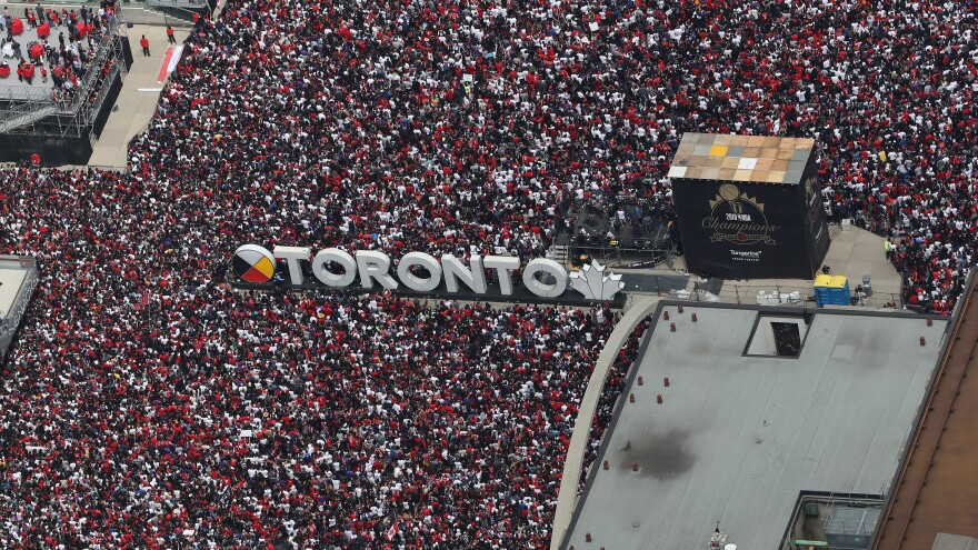 Fans gather at Nathan Phillips Square as they turn out for the Toronto Raptors NBA Championship Victory Parade on Monday in Toronto.