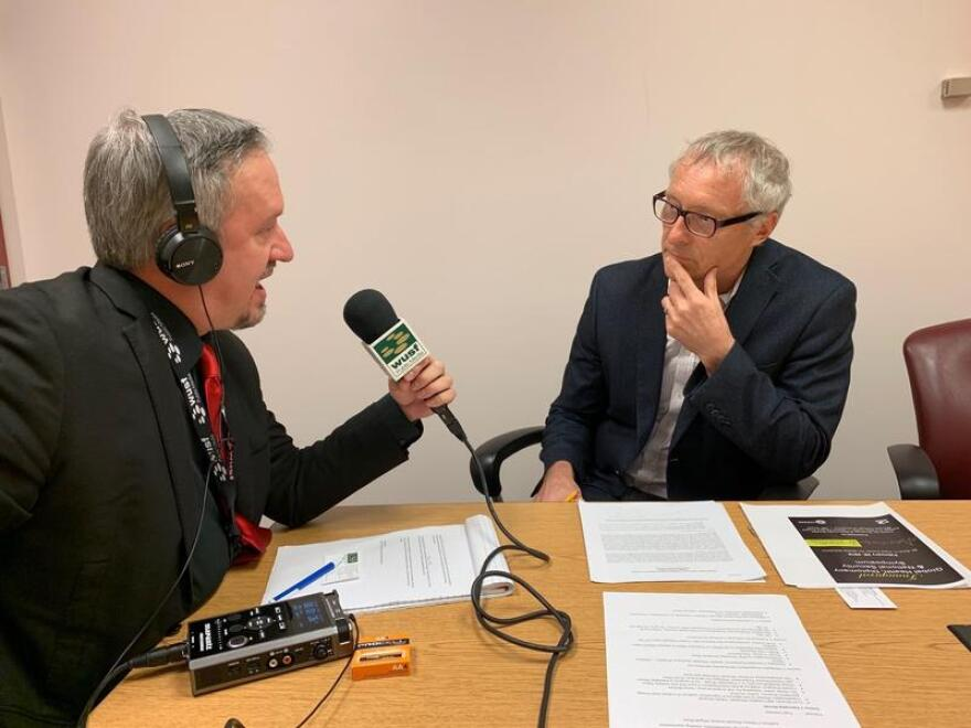Dr. Anthony Masys, right, the Director of Global Disaster Management, Humanitarian Assistance and Homeland Security at the USF College of Public Health, speaks to WUSF's Mark Schreiner.