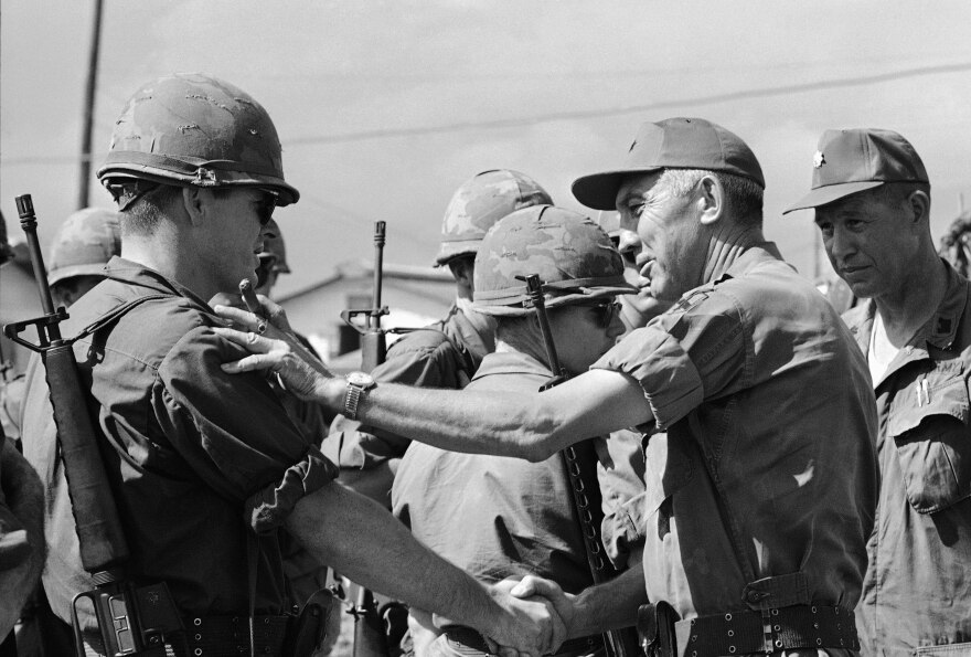 Lt. General William Peers, second from right, talks to an officer of the National Guard's 116th Combat Engineer Battalion of Idaho Falls, Idaho, at Phan Rang, South Vietnam, Saturday, September 18, 1968. At the time, many saw the National Guard as a way to get out of the draft, but eight units were ultimately sent to Vietnam, including the 116th Battalion.