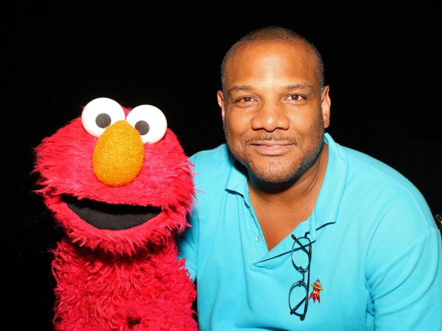 Puppeteer Kevin Clash and Elmo.