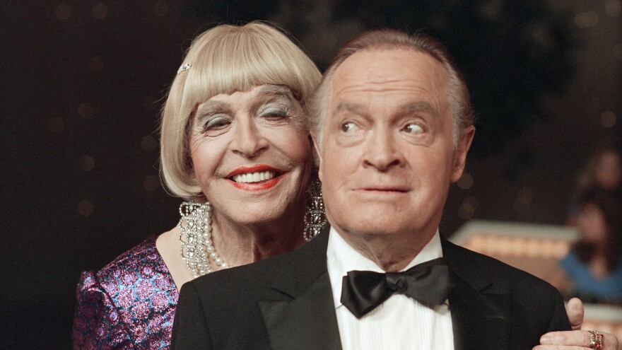 Milton Berle, in drag, performs a skit with Bob Hope during taping of the <em>Bob Hope Buys NBC</em> special at NBC Studios in Burbank, Calif., in 1985.