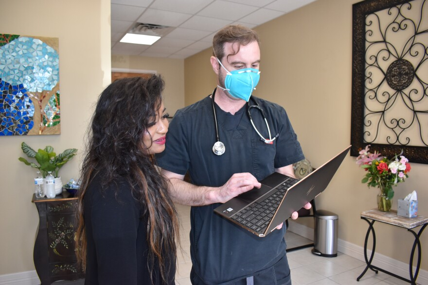 Shruti Konda, Chief Operations Officer for Centex Studies, and Westley Keating, a physician assistant and trial investigator, screen potential volunteers for COVID-19 vaccine trials at Centex's study site in McAllen