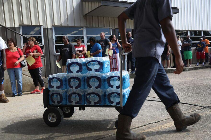 People wait in line to buy water at the Coastal Industrial and Specialty gas welding supplies store after the water supply to the city of Beaumont was shut down after Hurricane Harvey passed through on Aug. 31, 2017 in Beaumont, Texas. (Joe Raedle/Getty Images)