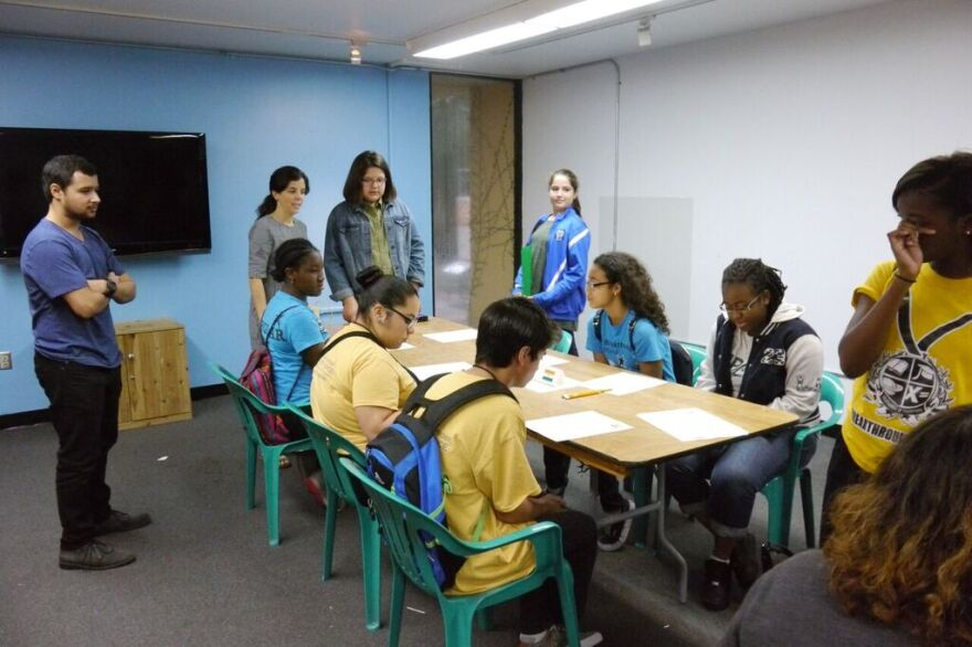 Students receiving information for their workshop on climate change.