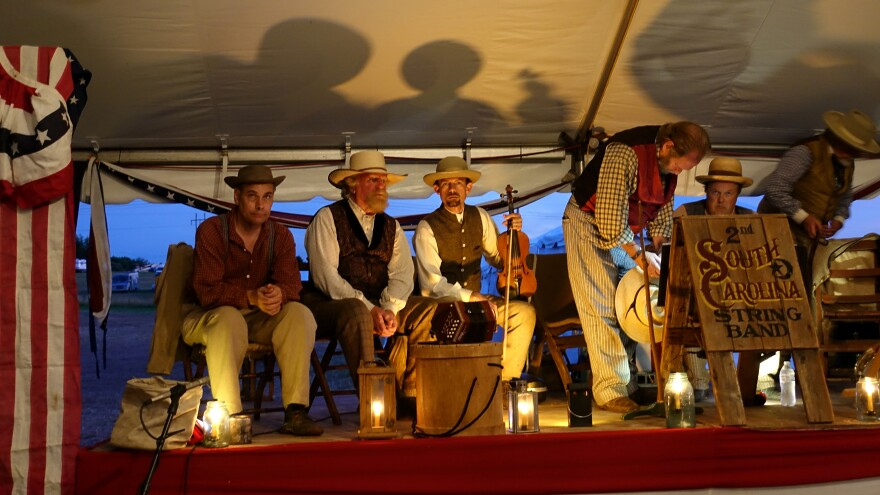 The 2nd South Carolina String Band in July, onstage in the main tent of the annual reenactment of the Battle of Gettysburg.