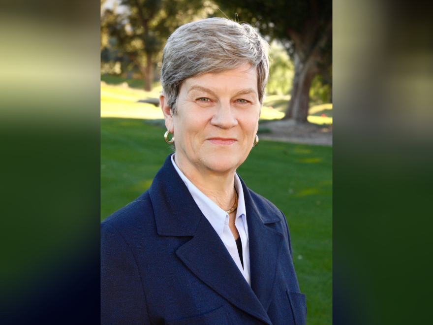 Portrait of Kathleen Hall Jamieson, wearing a blue blazer with a green park in the background.