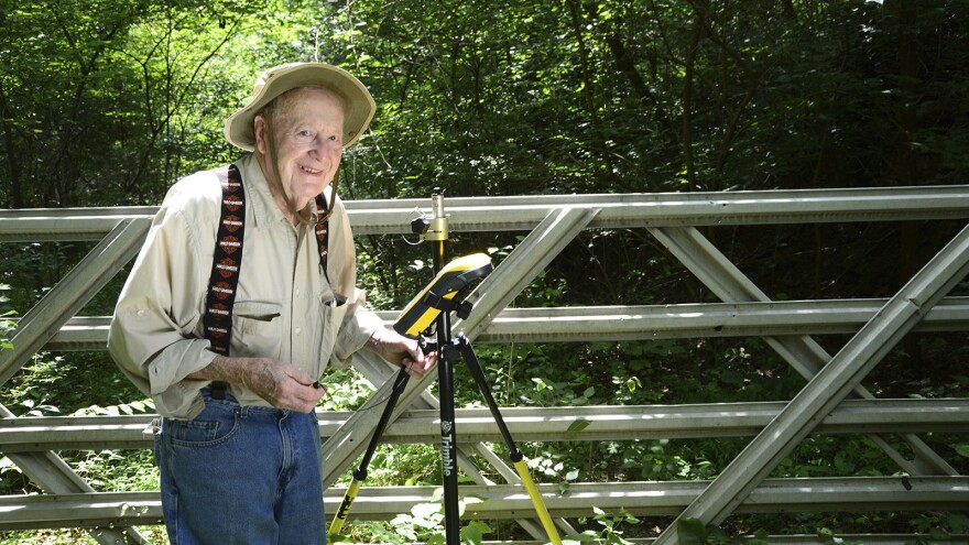 Bob Vollmer, at the age of 99, seen at work as a surveyor — more than a half-century after he took the job. Now 102, Vollmer says he's worn out his legs. But he still has big plans for life after retirement.