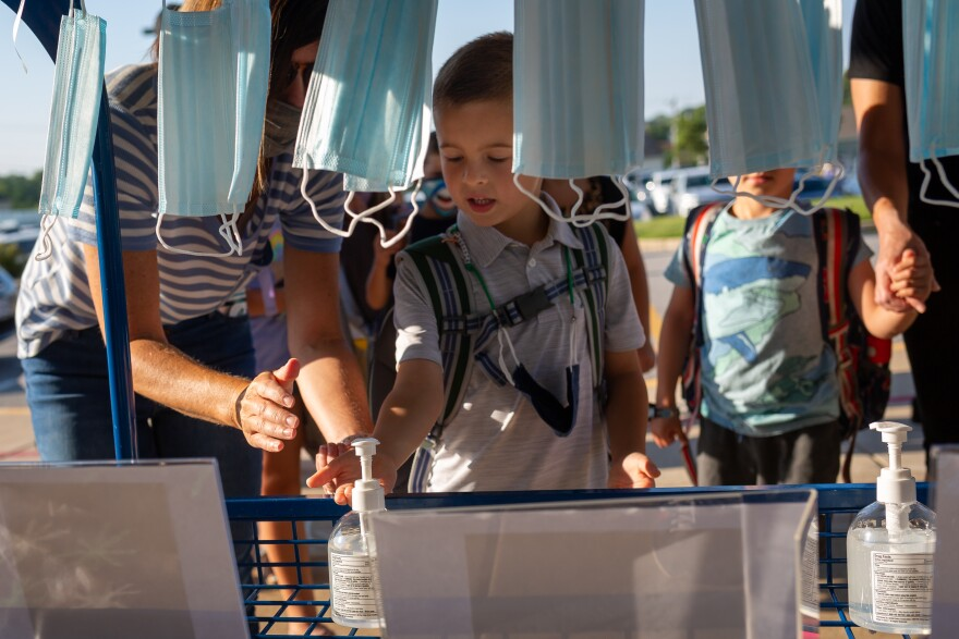 Students arrive for the first day of school Aug. 24, 2020, at Duello Elementary School, in Lake St. Louis. Wentzville is one of the few St. Louis-area school districts to open in person. It'll offer in-school instruction two days per week.