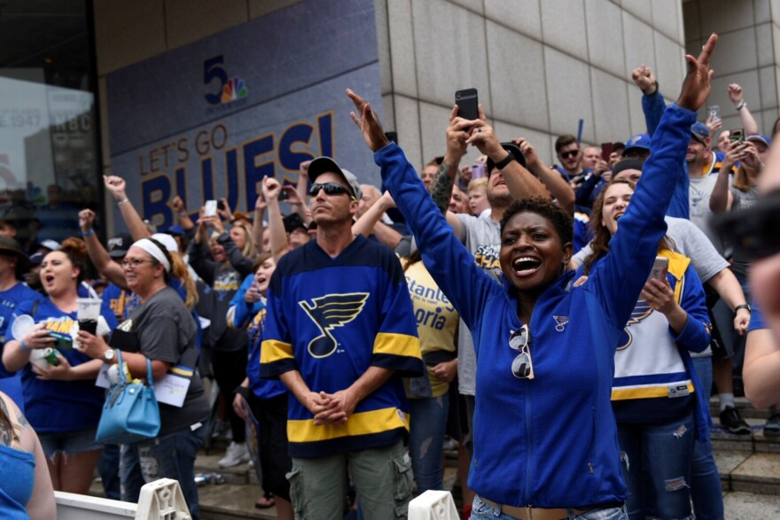 Fans cheer loudly as the Blues pass during the championship parade on Saturday, June 15, 2019.