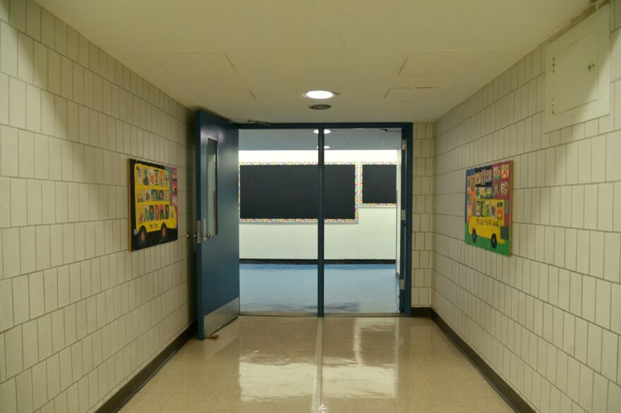 A hallway and billboard remain empty at Yung Wing School P.S. 124 in New York City.