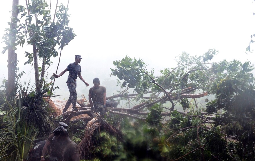 Sri Lankan military personnel engage in relief and rescue efforts Thursday in Aranayake. Heavy rains have hampered the search for survivors.
