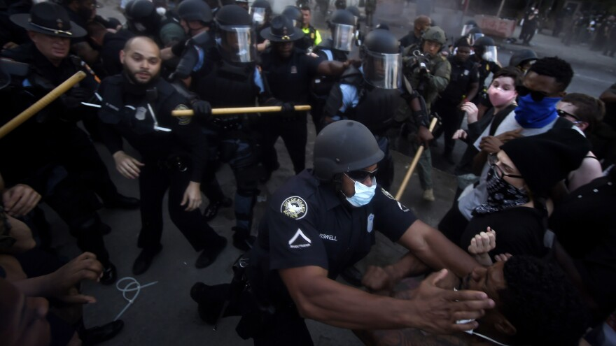 Police officers and demonstrators get into a scuffle during a protest that took place in May, over the killing over George Floyd and police brutality.