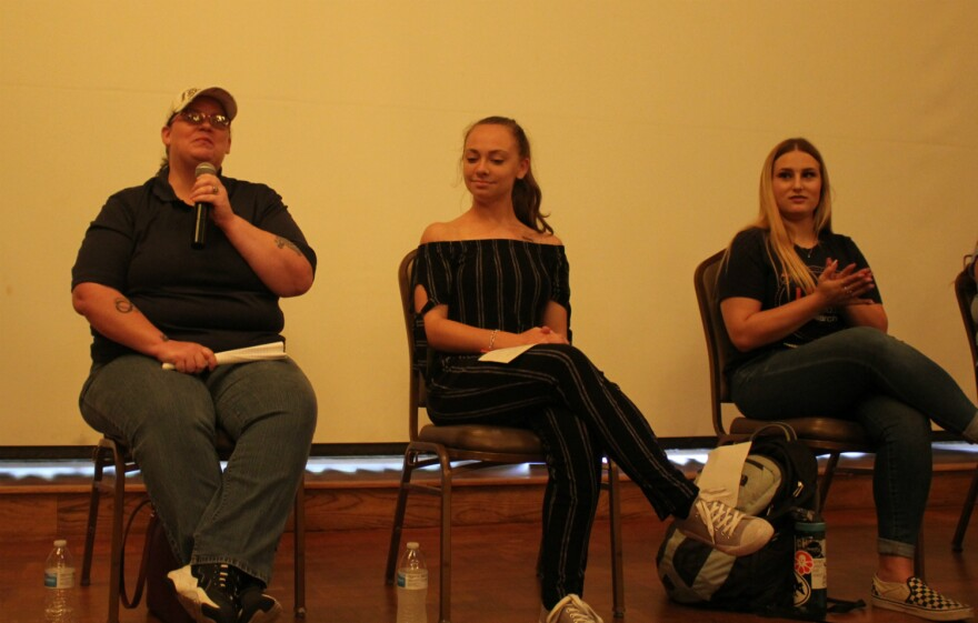 UTSA graduate student Gina Hill, left, speaks on a panel of students formerly in foster care July 23, 2019.