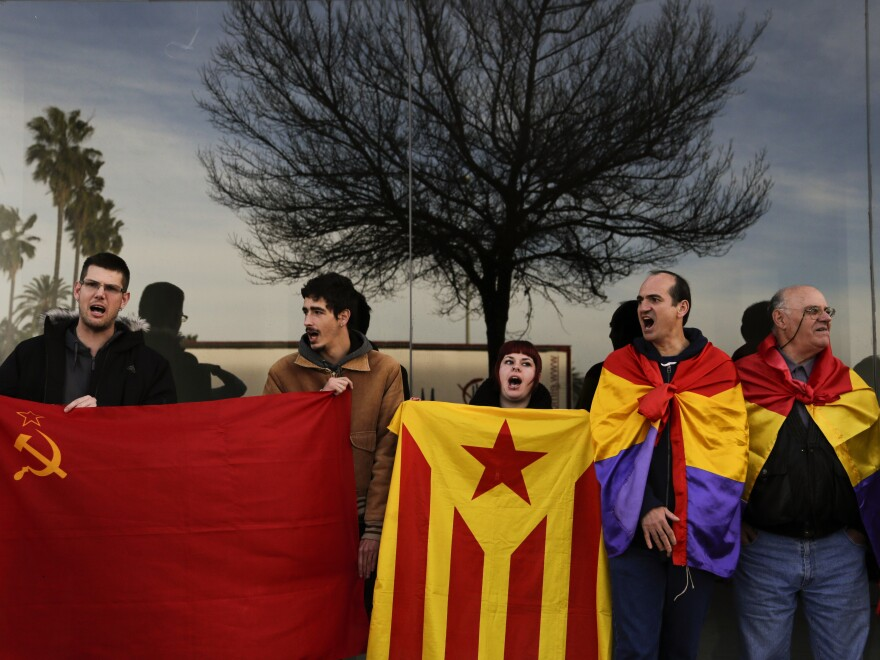 Anti-monarchy protesters gather Monday outside a makeshift courtroom after the arrival of Spain's Princess Cristina, in Palma de Mallorca.