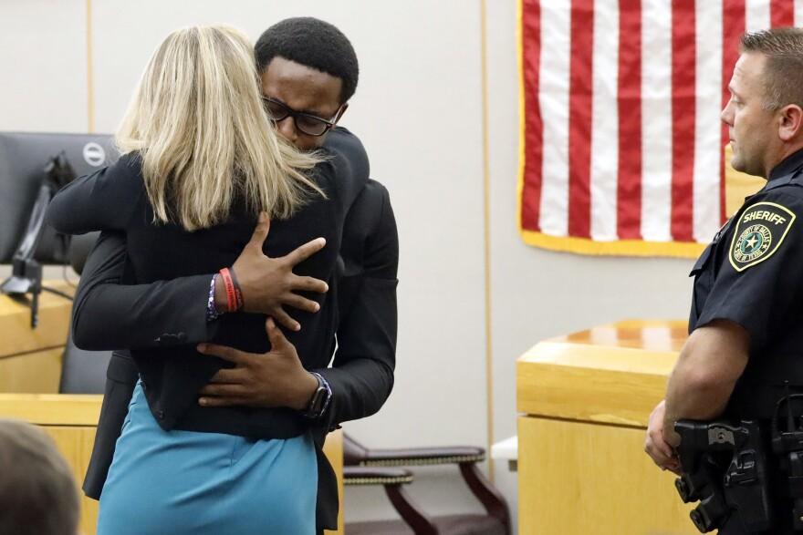 Brandt Jean hugs Amber Guyger after her sentencing.