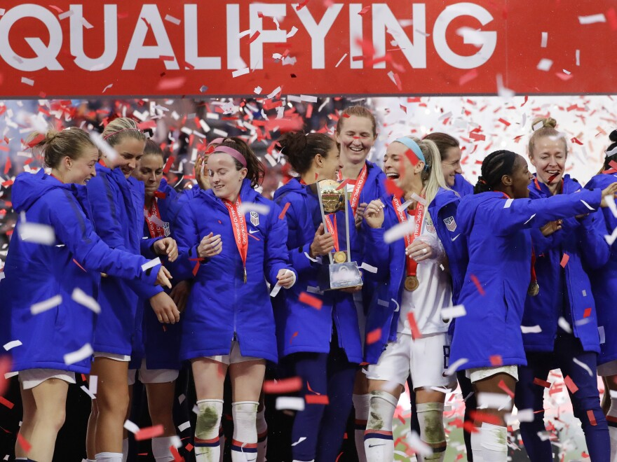 The United States Women's National Soccer Team celebrates after clinching the CONCACAF Olympic Qualifying tournament with a 3-0 win against Canada on Sunday. The team is heading to its seventh-straight Olympic games.