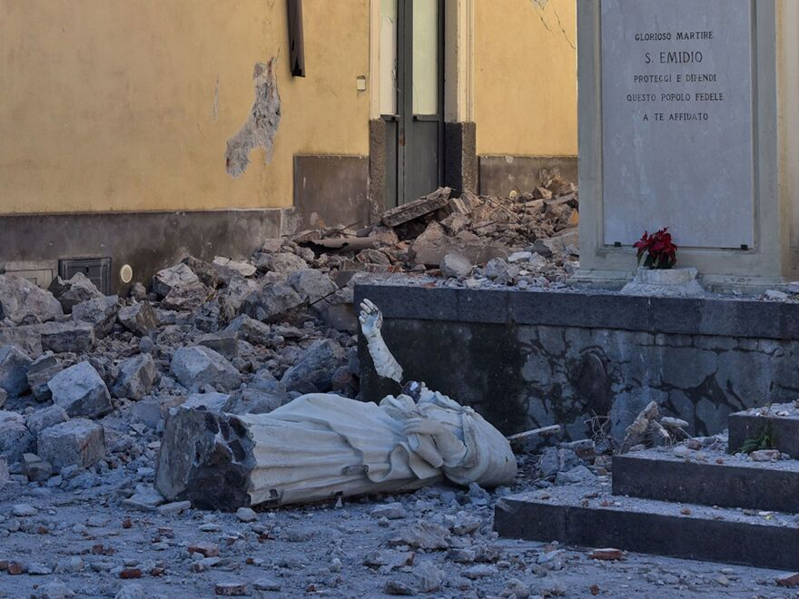 A toppled statue in Pennisi, Italy, on Wednesday.