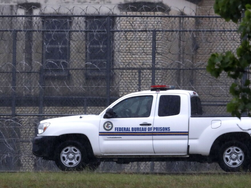 A Federal Bureau of Prisons truck drives past barbed wire fences at the Federal Medical Center prison in Fort Worth, Texas in May 2020.