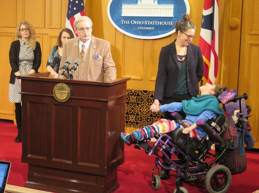 Photo of Minority Leader Kenny Yuko and Nicole Scholten and her daughter Lucy.