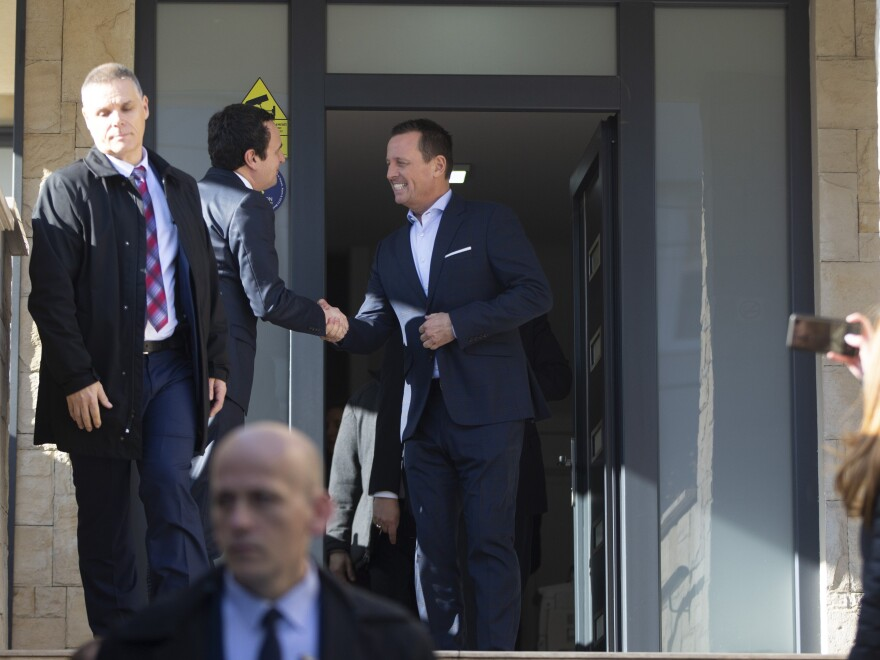 Albin Kurti (second left) shakes hands with U.S. special envoy for talks between Serbia and Kosovo Richard Grenell in Pristina on Jan. 23.