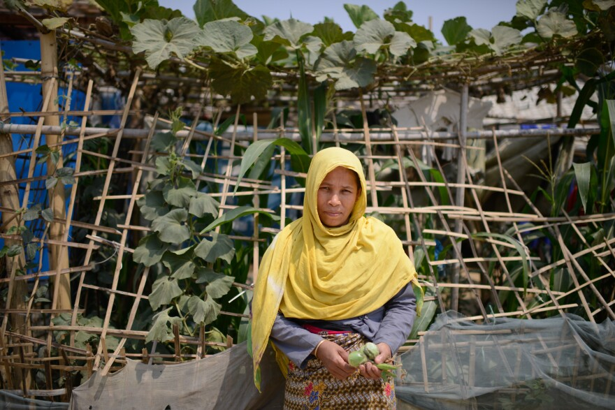 "Fatima Katu, 40, has started a small garden at her home in the refugee camp. Compared to her previous shelter in the camp, she says, ""We have more space here and now it feels like home."""