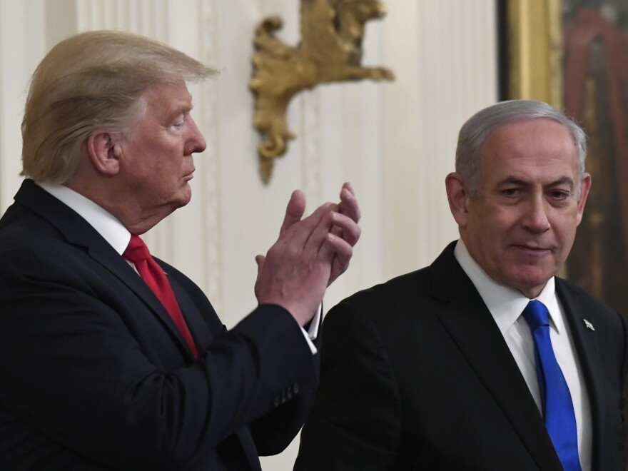 President Donald Trump applauds as Israeli Prime Minister Benjamin Netanyahu speaks during Tuesday's announcement of the Trump administration's plan to resolve the Israeli-Palestinian conflict.