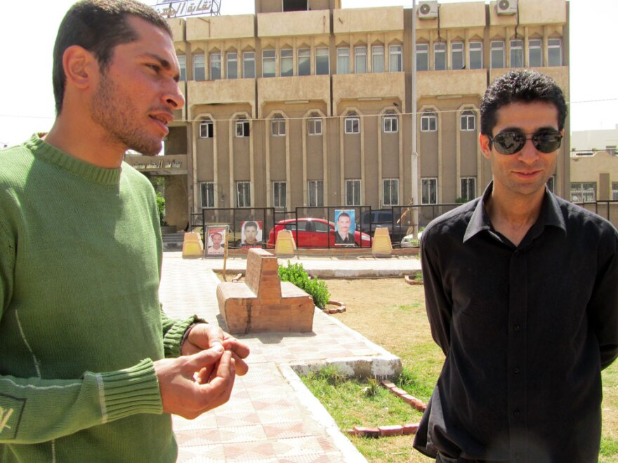 Hisham Haddad (left) stands with his brother, Hani, at the so-called Hyde Park in Suez, Egypt, while talking about the city's problems since the revolution.