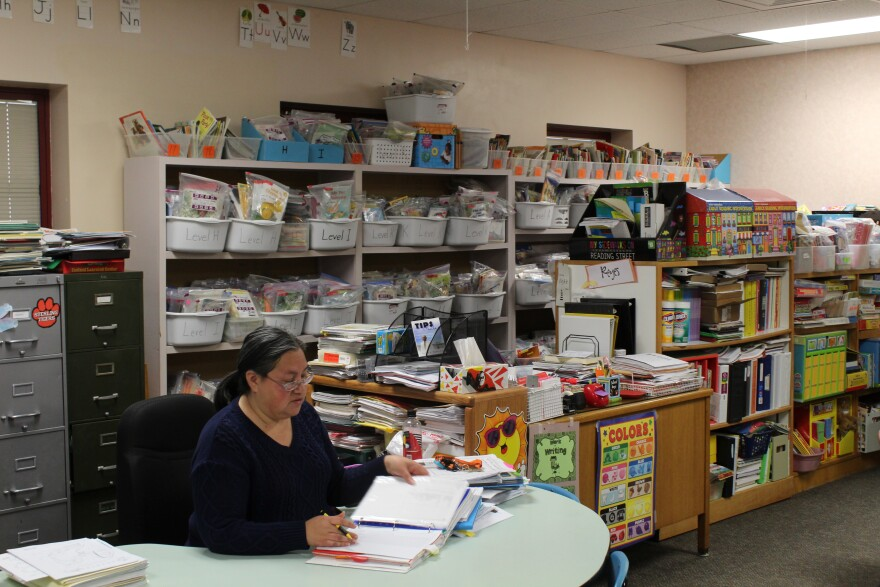 Dora Reyes looking over learning materials in her Ayers Elementary classroom.