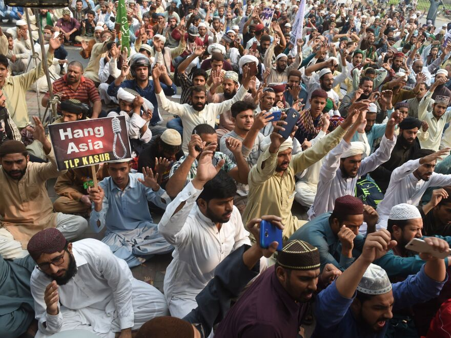 Supporters of Tehreek-e-Labaik Pakistan (TLP), a hard-line religious political party, chant slogans during a protest on Wednesday against the court decision to overturn the conviction of Asia Bibi.