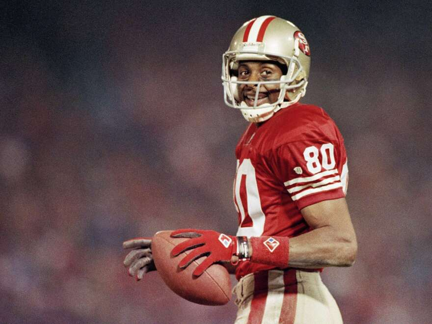 Jerry Rice smiles during a game on Dec. 3, 1994, at Candlestick Park in San Francisco.