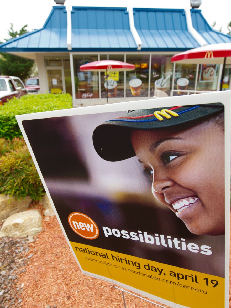 A sign outside a McDonald's restaurant in Fairfax, Va., advertises the company's hiring drive. Company officials say they hope the drive will not only fill openings, but also help change old stereotypes.