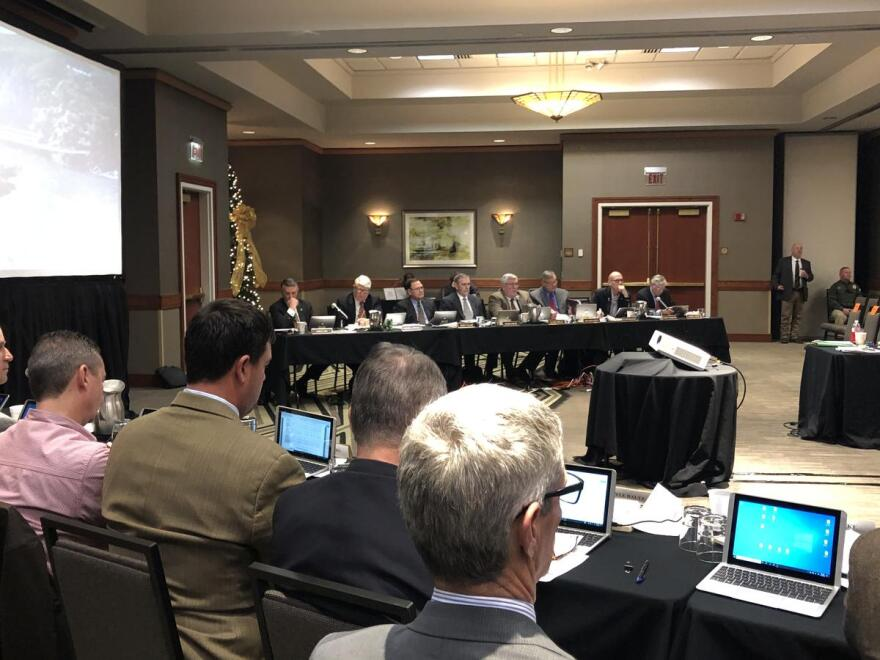 Members of the Arkansas Plant Board meet to discuss regulations on the herbicide dicamba at the Embassy Suites in west Little Rock on Dec. 11, 2019.