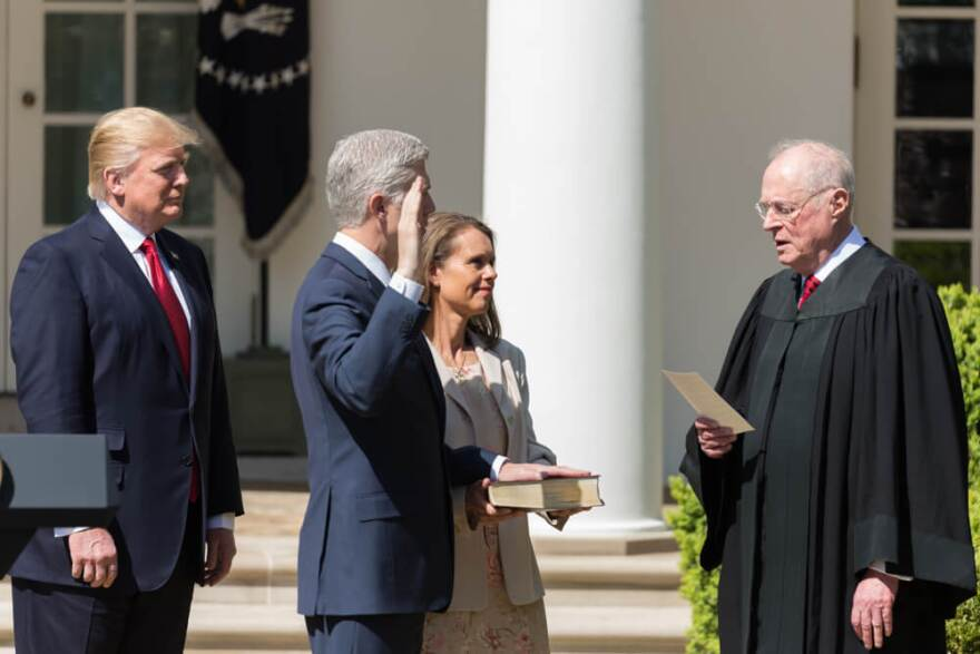 Anthony M. Kennedy, Associate Justice of the Supreme Court of the United States, swears in Supreme Court Justice Neil M. Gorsuch on Monday, April 10, 2017, in the Rose Garden of the White House in Washington, D.C.