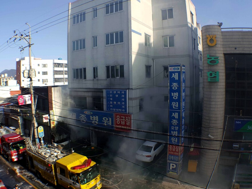 Rescue workers searched a scorched, smoke-filled hospital on Friday in Miryang, South Korea, after a deadly fire broke out in the emergency room.