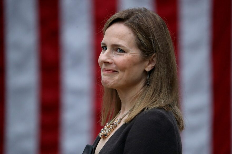 Seventh U.S. Circuit Court Judge Amy Coney Barrett looks on while being introduced by U.S. President Donald Trump as his nominee to the Supreme Court during an event at the White House.