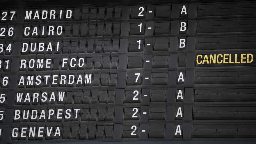 An information board indicating that a flight for Rome Fiumicino has been cancelled at the Brussels Airport in Belgium on Thursday. Coronavirus has swiftly upended lives around the world.
