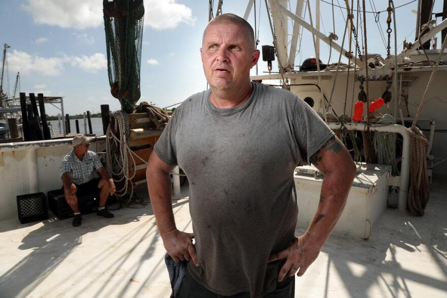 Shrimp boat captain Jessey Clapham on a boat at the Erickson and Jenson Seafood packaging facility in Aransas Pass.