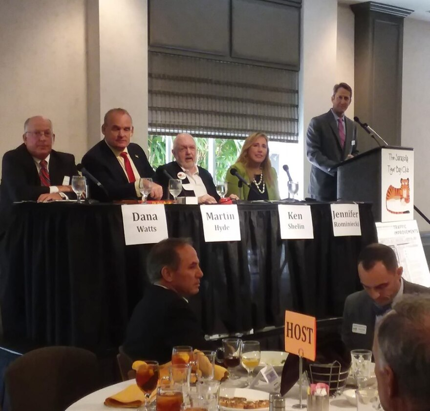 A panel featuring 4 people at Sarasota Tiger Bay Club.