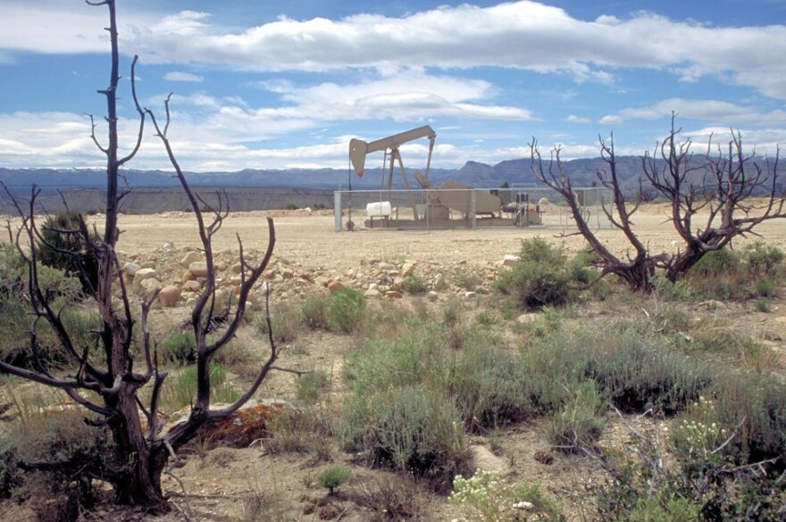 Photo of natural gas pump in the desert.